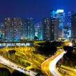 Highway and traffic in city at night — Stock Photo
