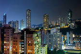 Hong Kong with crowded buildings at night — Stockfoto