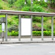 Blank advertising billboard on bus stop — Stock Photo