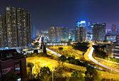 Traffic light through city at night — Stock Photo