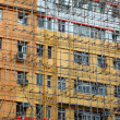 Bamboo scaffolding of repairing old buildings - Stock Photo