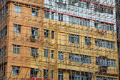 Bamboo scaffolding of repairing old buildings — Stock Photo