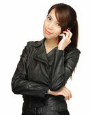 Asian young woman talking on phone — Stock Photo