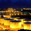 Oil tanks at night - Stock Photo