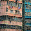 Bamboo scaffolding of repairing old building — Stock Photo #13963972