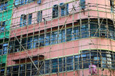 Bamboo scaffolding of repairing old building — Stock Photo