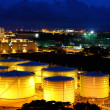 Oil tanks at night - 图库照片