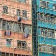 Bamboo scaffolding of repairing old building - Stock Photo