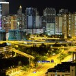 Downtown in Hong Kong at night - Stock Photo
