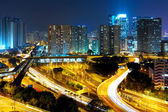 City highway and traffic in city at night — Stock Photo
