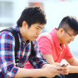 Two friend using phone — Stock Photo