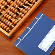 Chinese book and abacus — Stock Photo