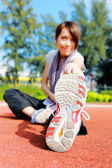 Woman doing stretching exercise in park — Stock Photo