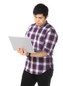 Young asian man using computer — Stock Photo