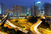 Highway and city at night — Stock Photo