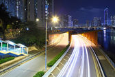 Road in city at night — Stock Photo