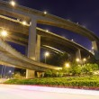 Crossing highway overhead at night — Stock Photo #24760711
