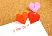 Origami paper hearts with message — Stock Photo