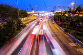 Futuristic urban city night traffic — Stock Photo