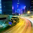Modern city with traffic at night — Stock Photo