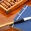 Stock Photo: Chinese book , abacus and writing brush