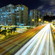 Highway at night in modern city — Stock Photo #24874565
