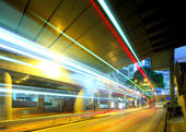 Light trails in city at night — Stock Photo