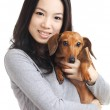 Asian woman with dachshund dog — Stock Photo #24951971