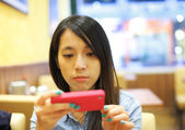Asian woman using mobile phone take photo in restaurant — Stock Photo