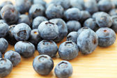 Blueberry on wooden background — Stock Photo