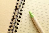 Spiral notebook with pen — Stock Photo