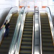 Blurred person on escalator — Stock Photo #25158251