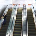 Blurred person on escalator — Stock Photo