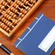 Chinese book , abacus and writing brush — Stock Photo
