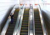 Blurred person on escalator — Stockfoto