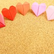 Origami colorful heart on corkboard — Stock Photo #25608037