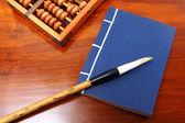 Chinese book , abacus and writing brush — Stock Photo