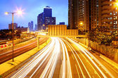 Cityscape at night with light trail — Stock Photo