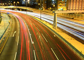 Traffic on highway at night — Stock Photo