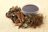 Herbal drink on the linen table — Stock Photo