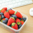 Healthy lunch box at office — Stock Photo