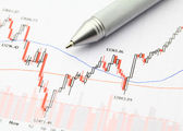 Stock market graph with pen — Stock Photo