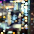 Blurred unfocused city view at night — Stock Photo