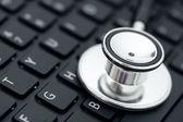 Stethoscope on keyboard — Stock Photo