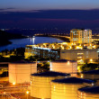 Oil tank in cargo terminal at night — Stock Photo