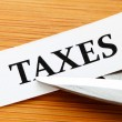Stock Photo: Taxes deduct