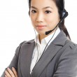 Asian business woman with headset — Stock Photo #26397403