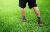 Male legs in lawn — Stock Photo