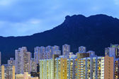 Hong Kong cityscape with lion rock at night — Stock Photo