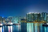 Apartment Buildings in Hong Kong at night — Stock Photo